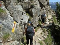 Photo of people hiking in Switzerland, on the trail to the Cabane d'Orny above Champex-Lac