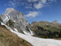 Photo of a hiker on the 1 Via Alpina trail in Switzerland, near the Gummfluh