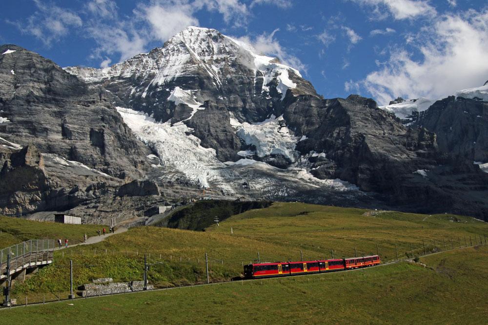 Photo of the Jungfraujoch train near Kleine Scheidegg | Scenic mountain trains in Switzerland