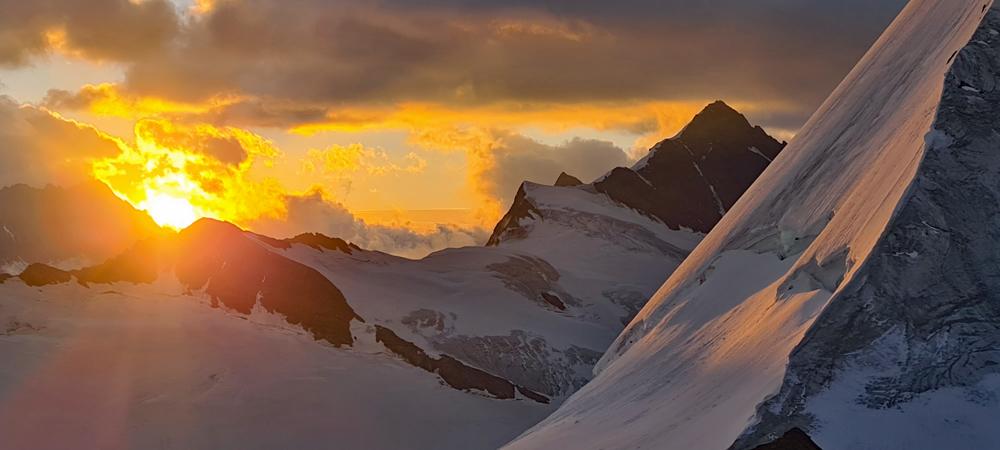 Photo of the sunrise from Mönchsjochhütte | Hiking in Switzerland