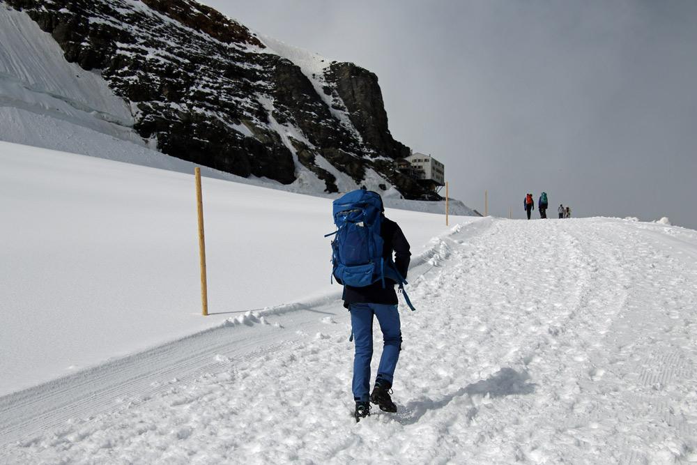 Photo of hikers on the Jungfraujoch to Mönchsjochhütte Aletsch glacier walk | Hiking in Switzerland